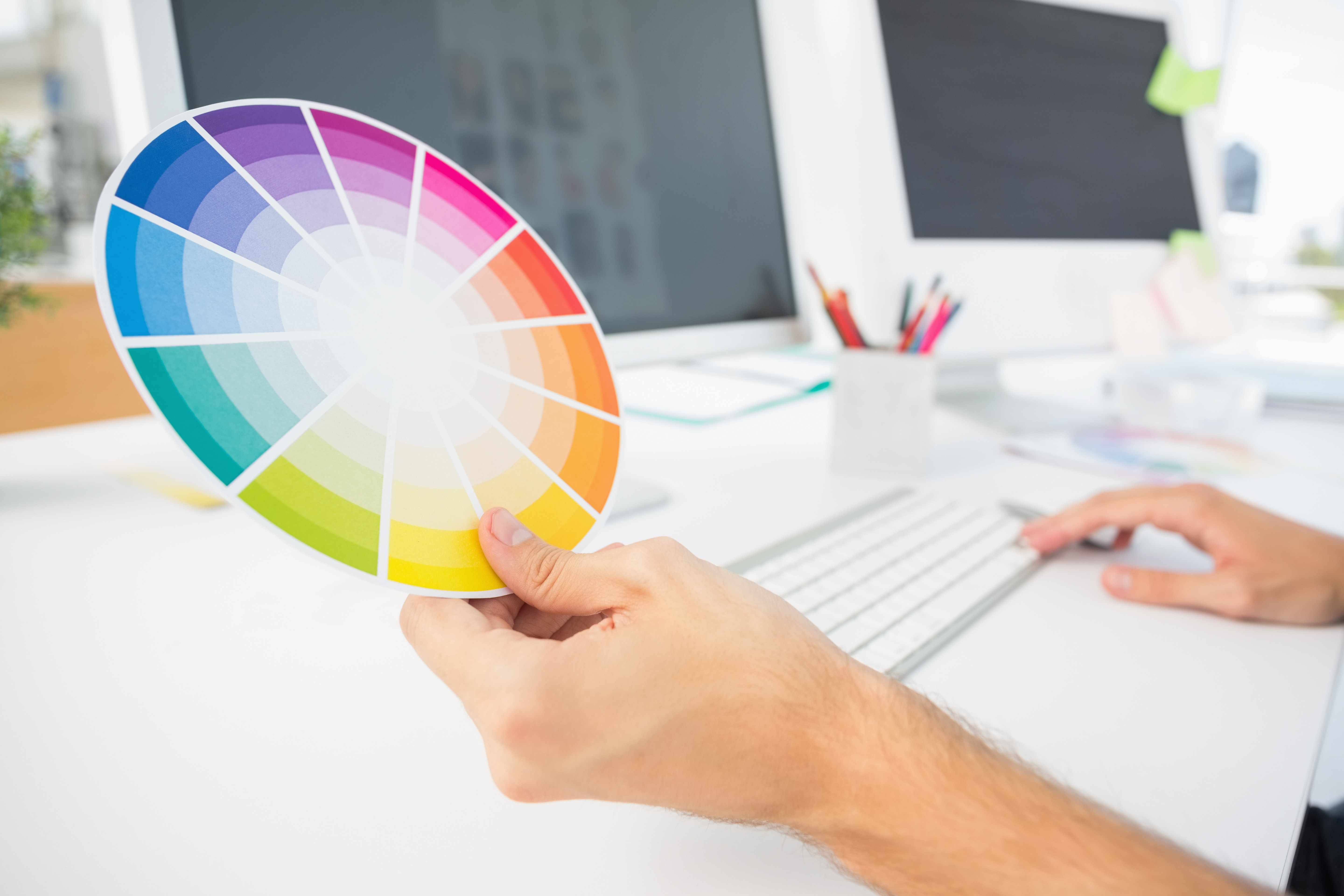 A graphic designer considers a color wheel